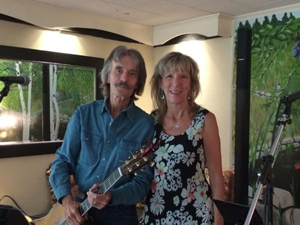 Local musicians Curt and Jenn performing at Clay Hill Farm