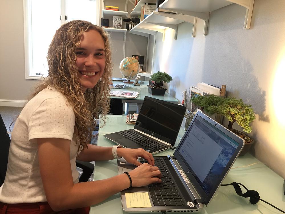World Table Intern, Lauren Lethbridge, at her desk in the WTSJ Lab.