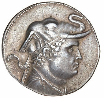 Silver tetradrachm of Demetrios, son of Euthydemos. Demetrios was a 2nd century BC Greek king, ruling over a landlocked kingdom in what is now northern Afghanistan. He wears an elephant skin headdress to celebrate his conquest of northern India.