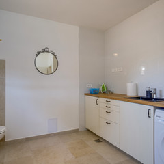 Laundry room and separate toilet - ground floor