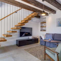 Living room and stairs to the first floor