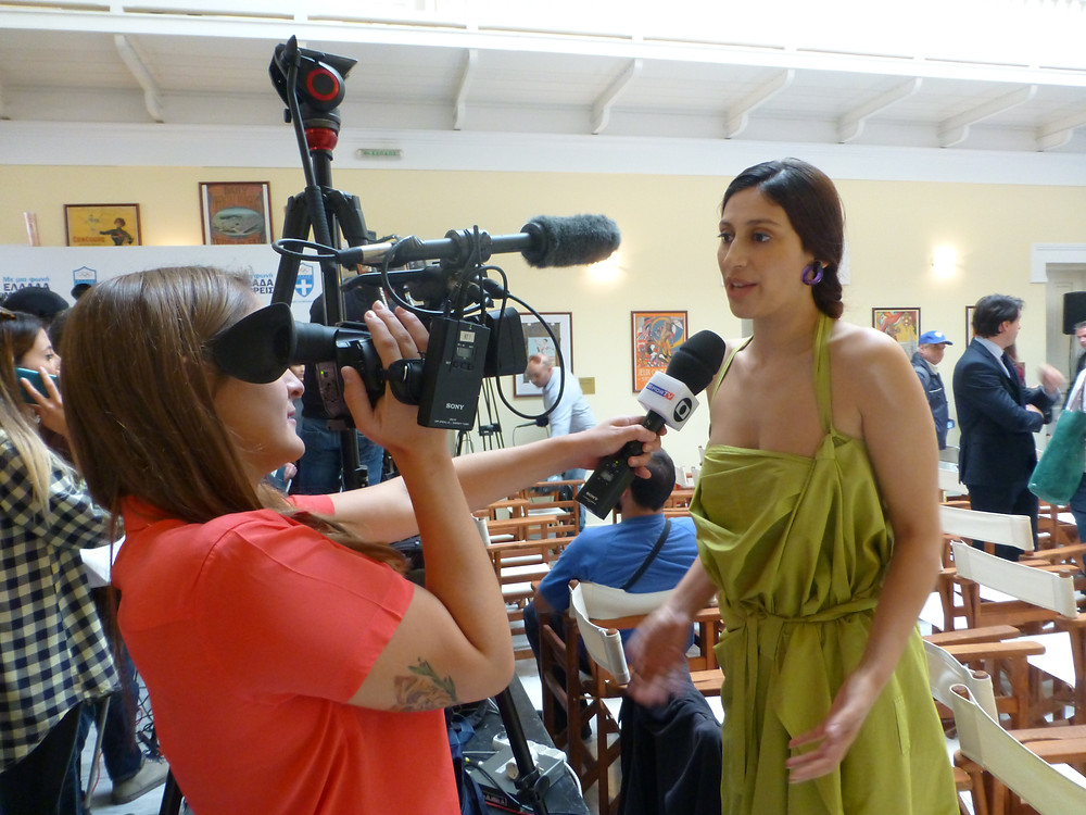 Eleni Kyriacou being interviewed for Brazilian TV channel SporTV