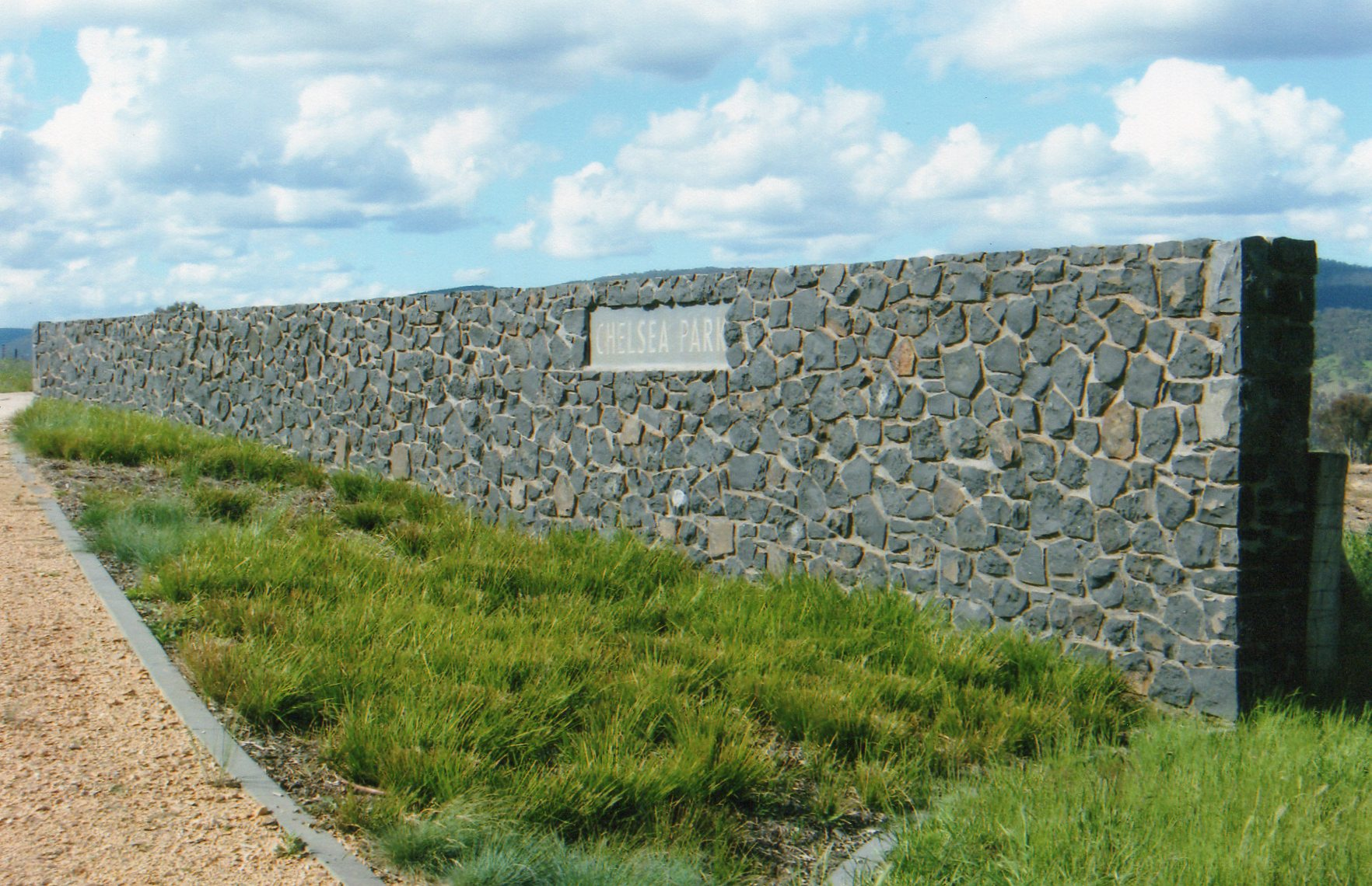 Basalt entrance wall and signage