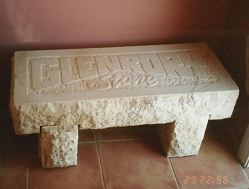 Garden seat with carved name