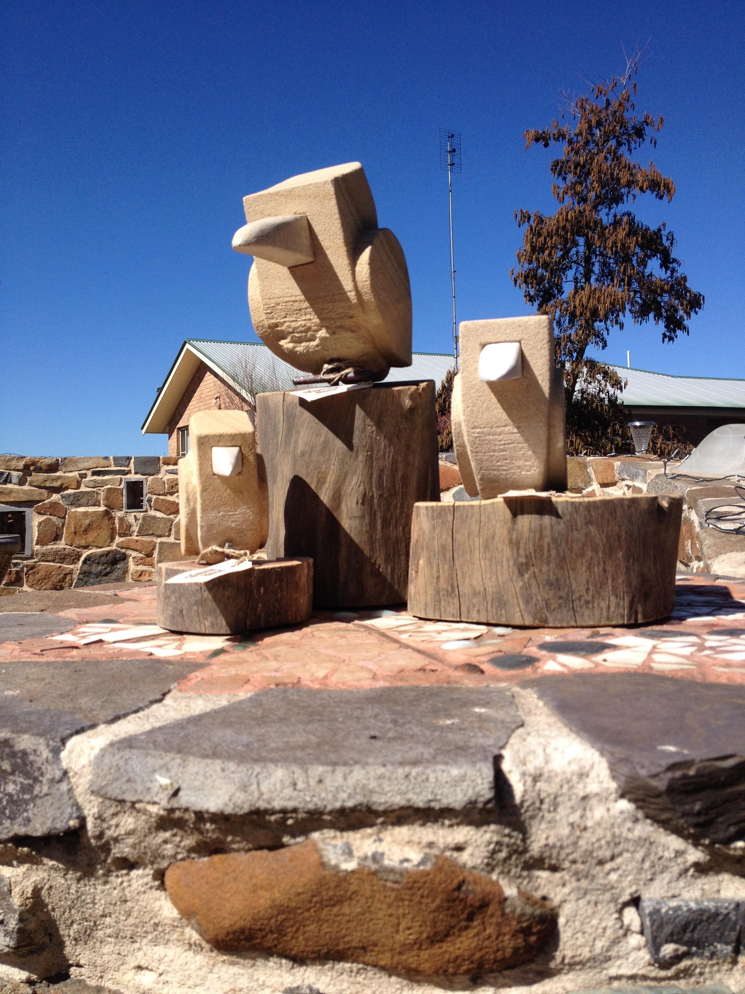 Sandstone Kookaburras on timber base