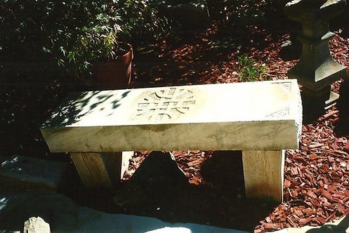 Sandstone seat with celtic carving