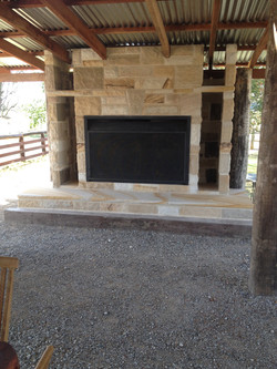 Sandstone fireplace and hearth