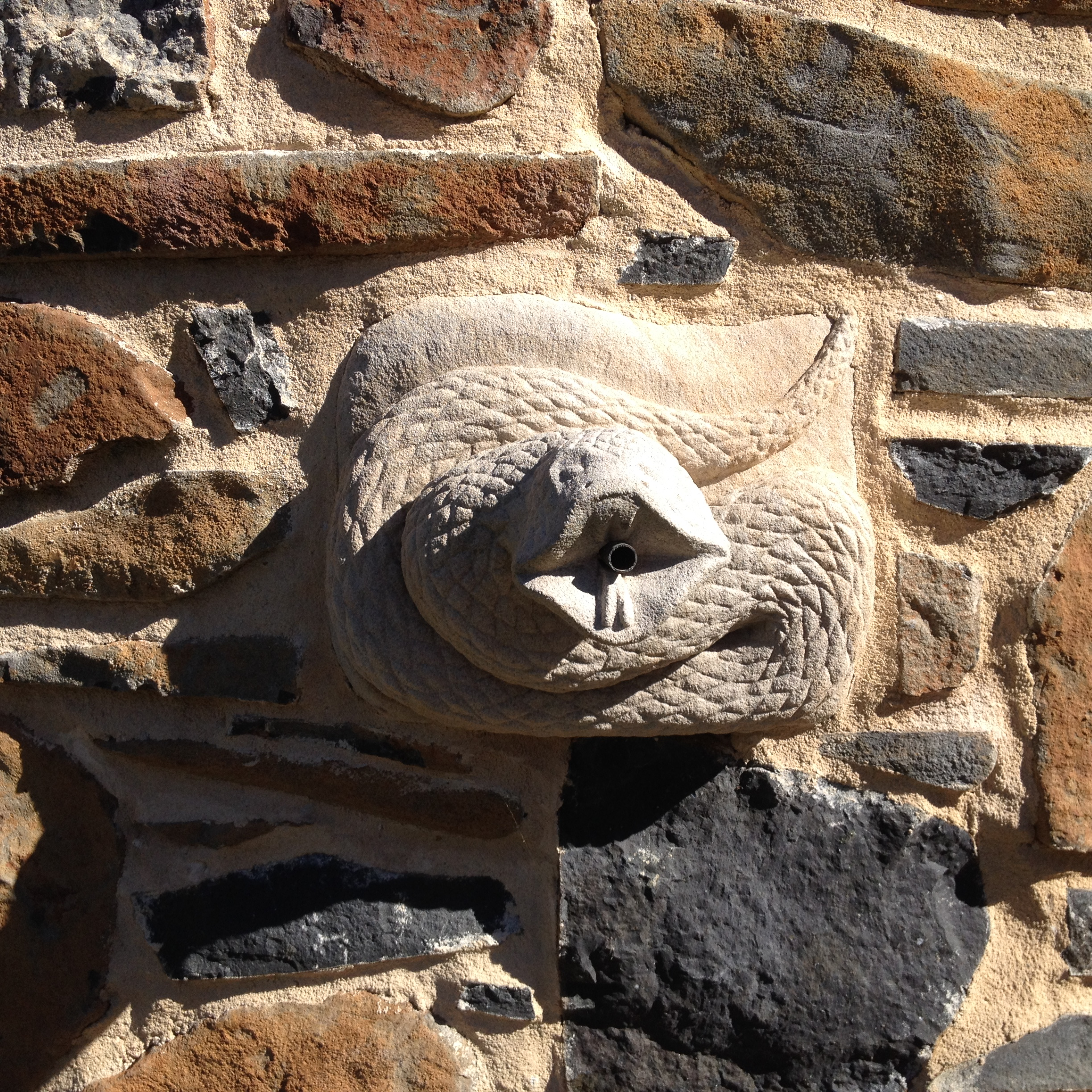 sandstone snake as water feature