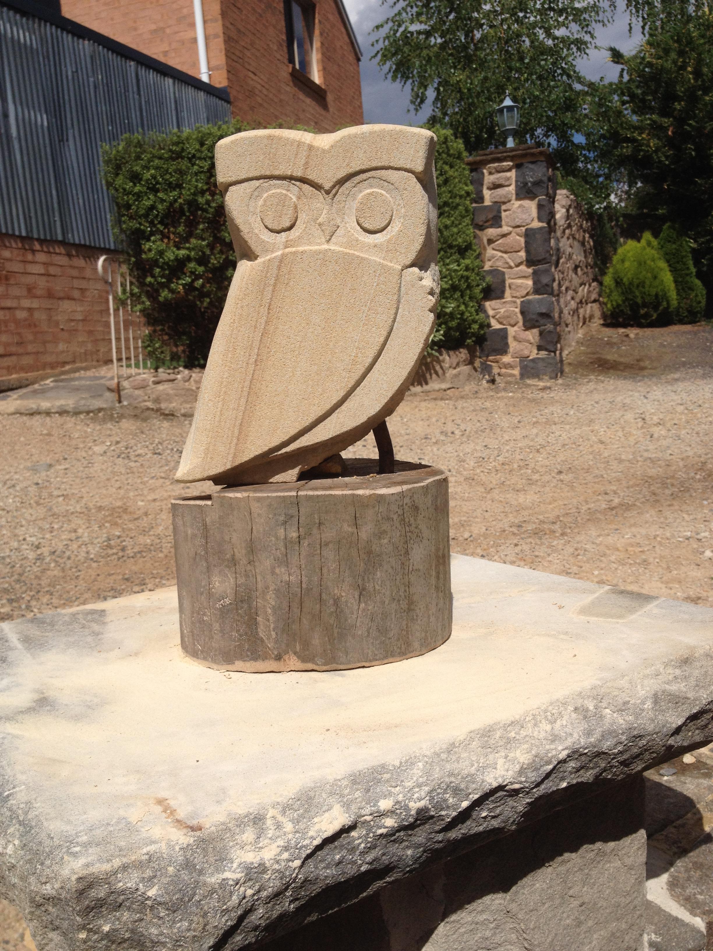 Sandstone owl on timber base
