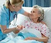 nurse with geriatric pt photo.JPG