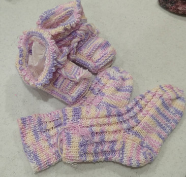 Knitted baby socks and bootees