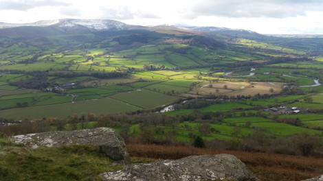The road to Brecon runs along the river Usk, down in the valley