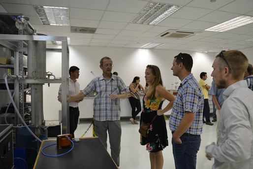 Touring the research facility with Brazilian scholars
