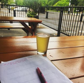 Taking notes and trying local cider