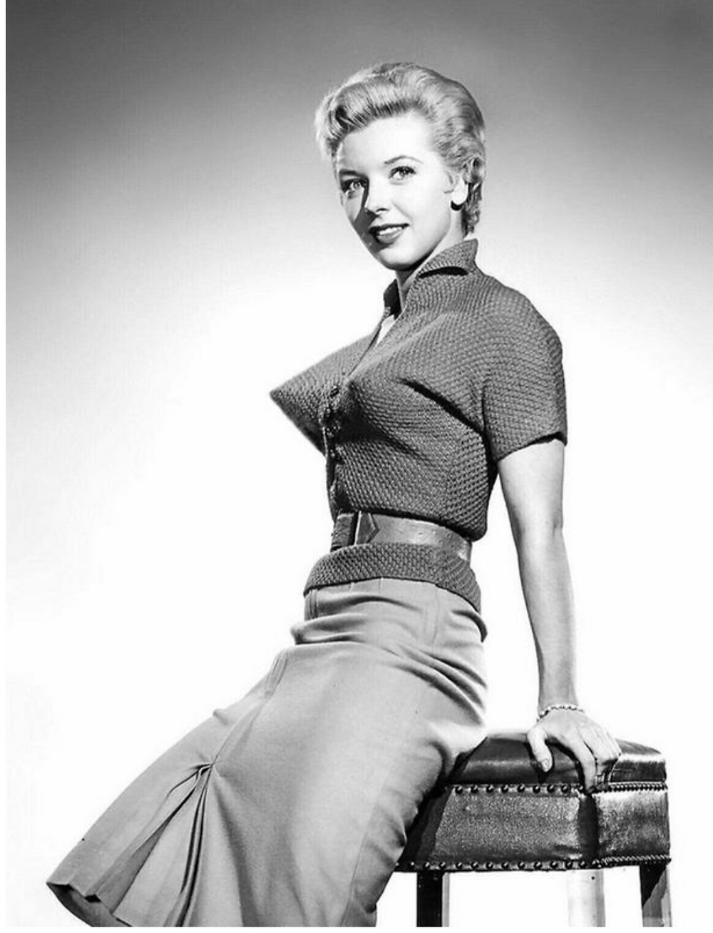 1950's woman in a tight sweater with Bullet Boobs
