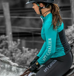 branded equestrian blue base layer with black riding leggings