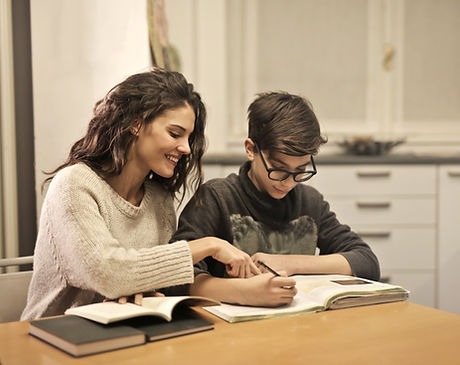 Canva - Elder sister and brother studyin