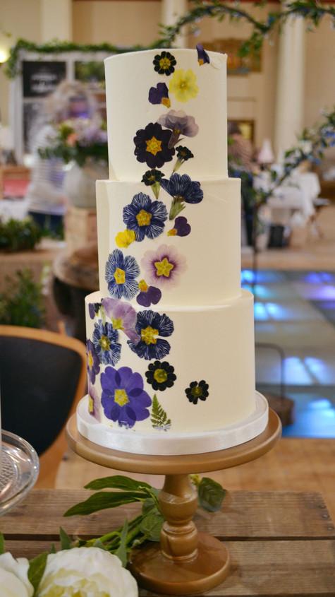 pressed edible flower buttercream wedding cake