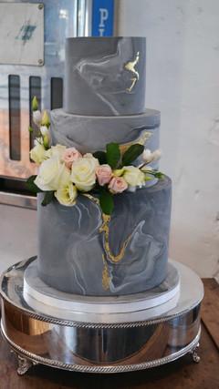 grey marbled wedding cake with gold leaf details