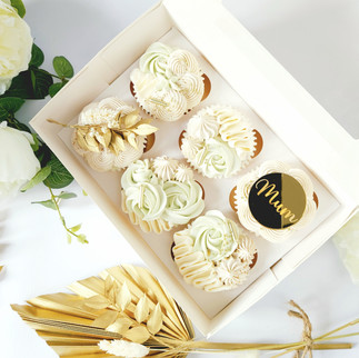 gold and light green mothers day cupcakes