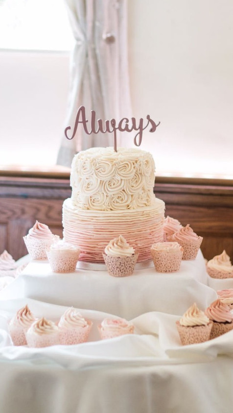 piped pink ombre buttercream cake and cupcakes