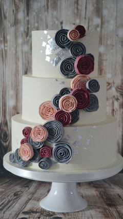 piped buttercream and silver leaf wedding cake