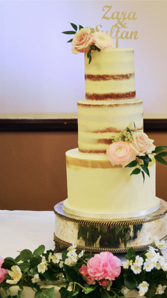 buttercream and semi naked cake with painted gold stripe