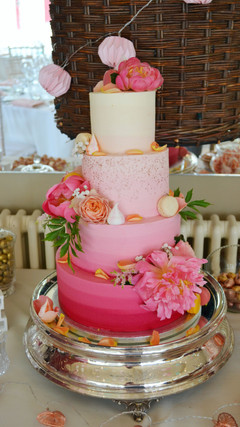pink ombre buttercream cake with fresh peonies
