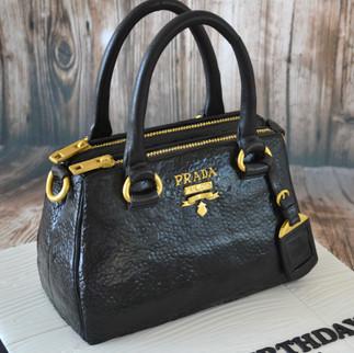 realistic Prada handbag cake