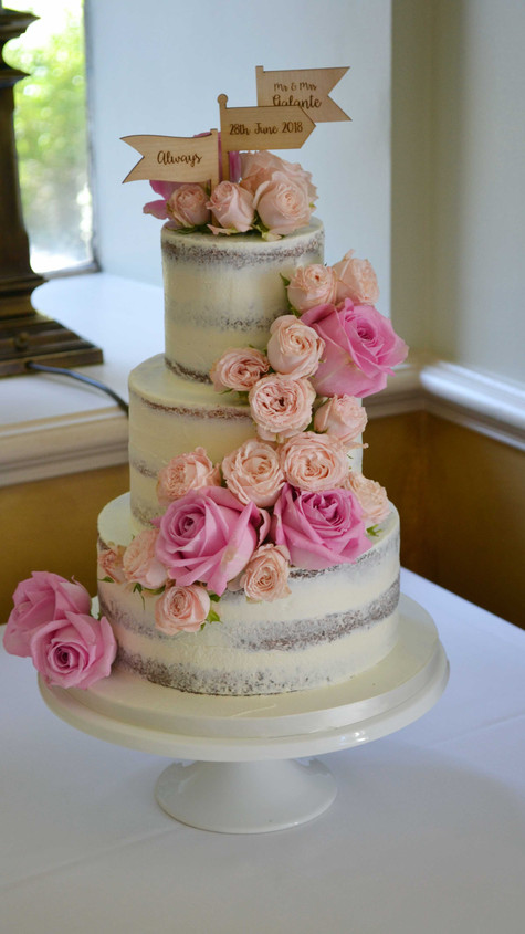 peach and pink cascading roses wedding cake