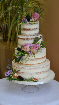 semi naked wedding cake with fruit and figs