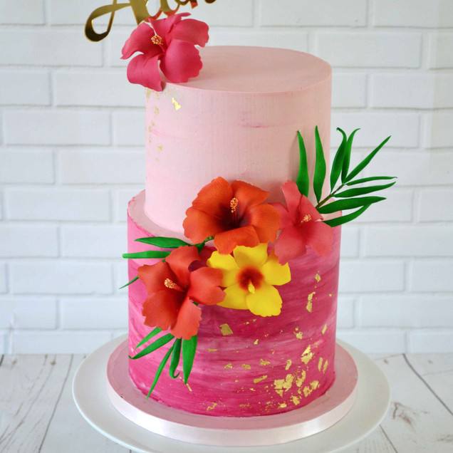 pink buttercream tropical aloha cake