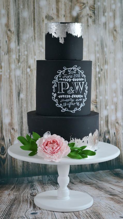 chalkboard monogram wedding cake with silver leaf