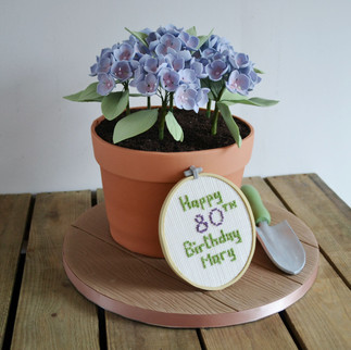 flower pot and cross stitch cake