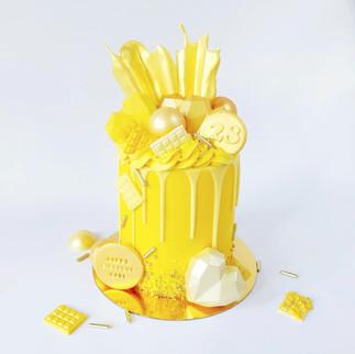 yellow and gold drip cake