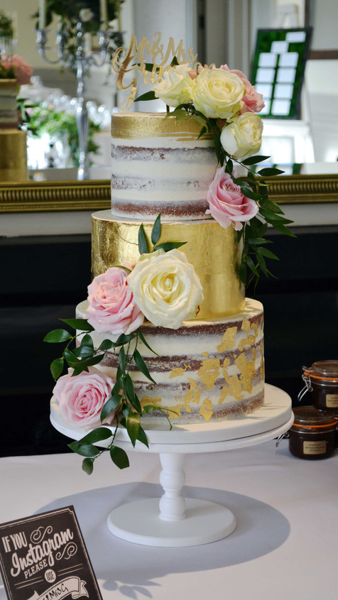 semi naked buttercream cake with gold leaf tier