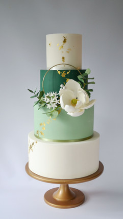 4 tier white gold and green wedding cake with sugar flower hoop