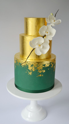 gold and emerald green wedding cake with sugar orchid spray