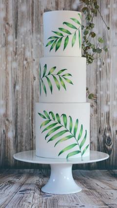 hand painted tropical leaf wedding cake
