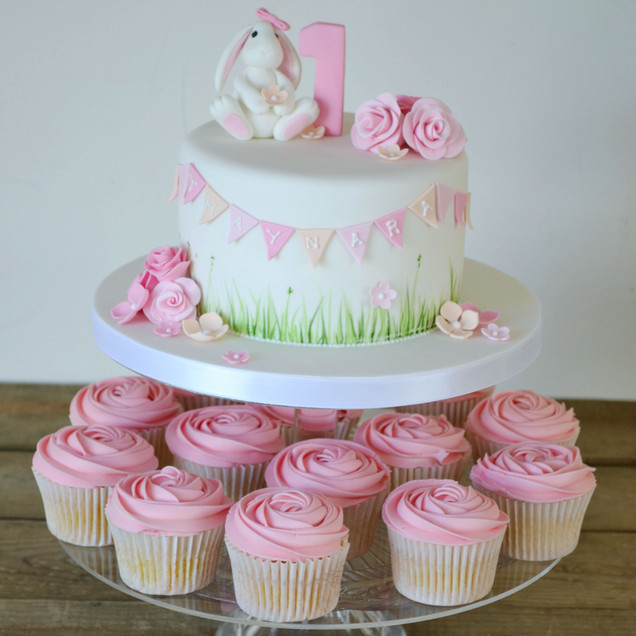 childrens bunny rabbit birthday cake and pink rose cupcakes