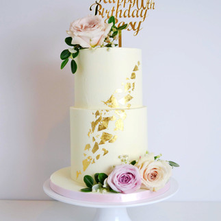 speckled gold leaf and buttercream birthday cake