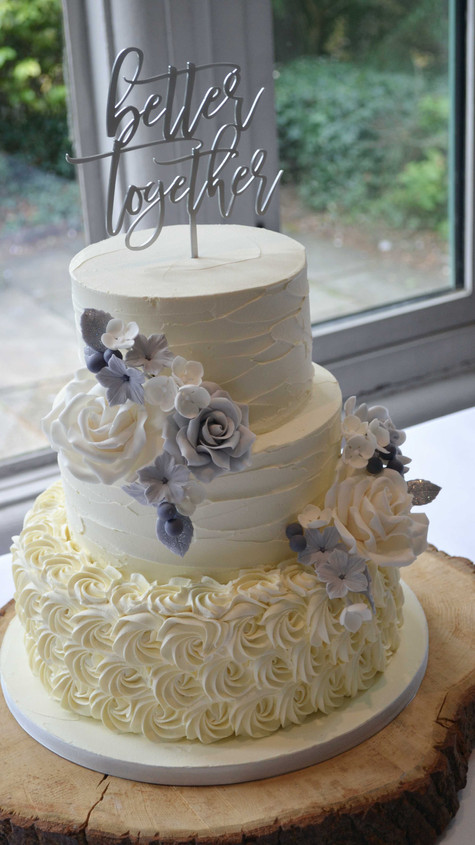 piped rose buttercream wedding cake, grey and white