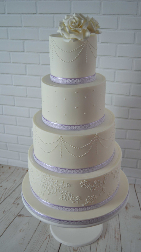 four tier sugarpaste wedding cake with royal iced detail