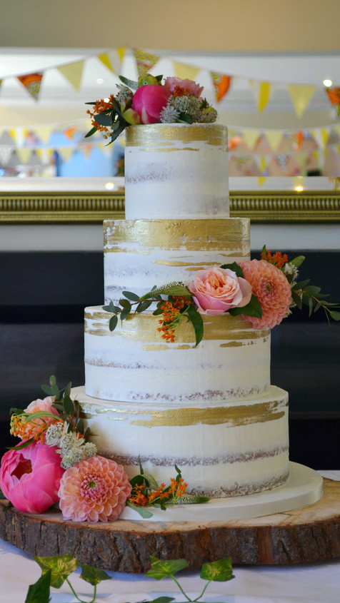 painted gold detail semi naked cake