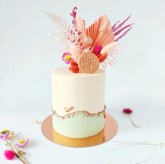 buttercream cake with dried flower decoration