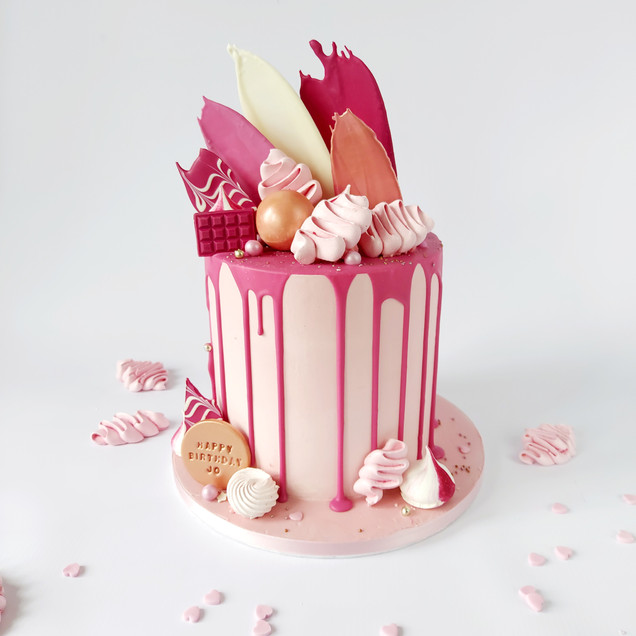 pink drip cake with meringue kisses