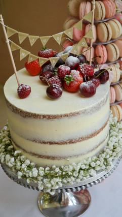 single tier semi naked cake with gypsophelia wreath