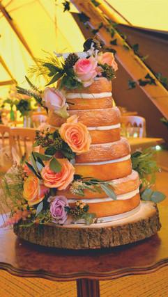 cascading fresh flower naked wedding cake