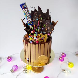 smarties explosion drip cake