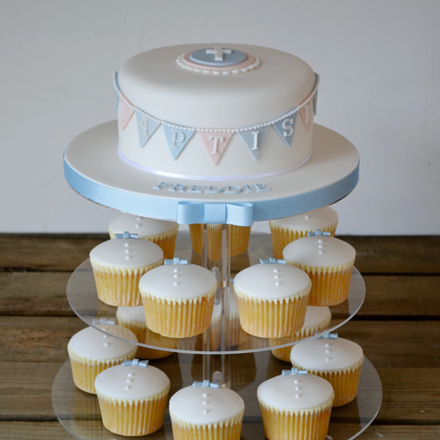 bunting and bow tie christening cake and cupcakes